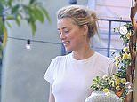 Amber Heard laughs as she clears out garage with girlfriend Bianca Butti