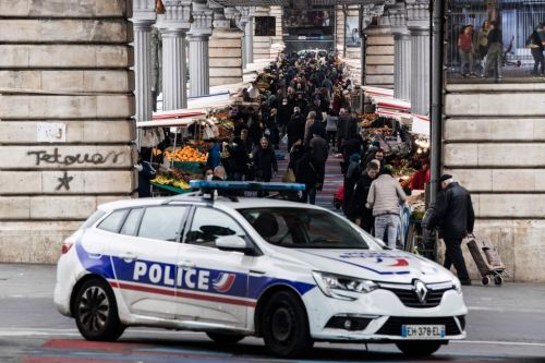 Woman bundled to ground by police for breaking lockdown in Paris