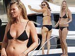 Kate Moss, 46, shows off her incredible figure in tiny black bikini on luxury yacht in Ibiza
