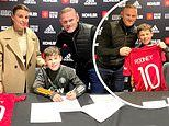 Wayne and Coleen Rooney pose with son Kai, 11, as he signs with Manchester United