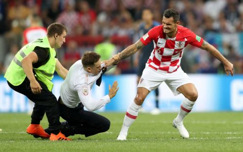 Incredible pictures show Dejan Lovren dragging Pussy Riot protester to ground during World Cup final