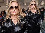 Jennifer Coolidge looks impossibly chic in a black satin trench coat at Paris Fashion Week