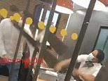 Moment McDonald's worker hurls plastic screen at unruly customer who threw straws in her face