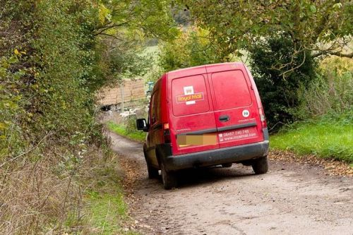 Postman dies while delivering parcels as Royal Mail van rolls down steep hill