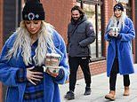 Olivia Attwood clutches her stomach during casual stroll with fiancé Bradley Dack