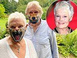 Dame Judi Dench channels Cats as she dons an animal face mask for a trip to a wildlife centre