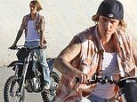 Justin Bieber adopts a bad boy image as he rides a dirt bike on the banks of the Los Angeles River