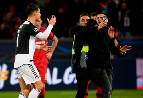 Juventus star Cristiano Ronaldo furious with pitch invader who grabbed him by the neck