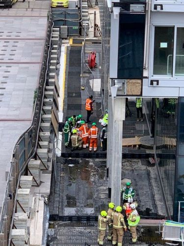 Two rushed to hospital after construction platform crashes through 10 storeys at London building site