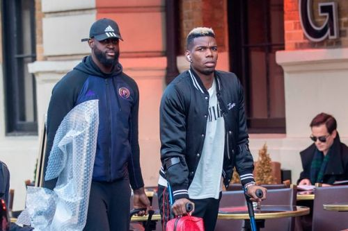 Paul Pogba arrives back in UK on crutches after Man Utd star attends Paris fashion show