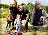 Jacqueline Jossa and Dan Osborne take their daughters strawberry picking for the first time