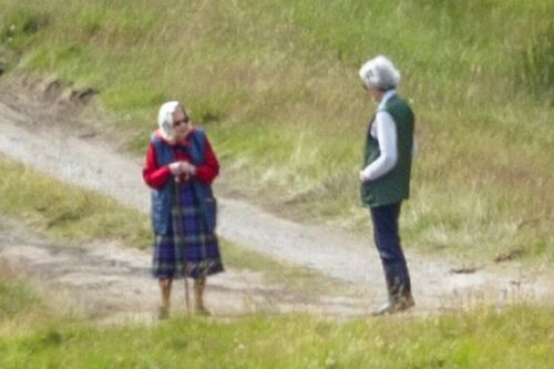Queen dons tartan as she enjoys sunshine stroll with walking stick in Balmoral