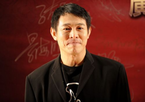 Martial arts legend Jet Li looks unrecognisably frail as he poses with fan