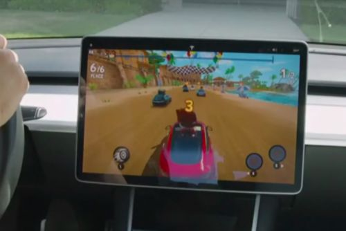 Tesla's Elon Musk demos in-car video games, says YouTube is coming too