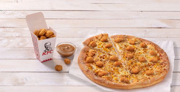 Brace yourselves, KFC and Pizza Hut have joined forces to create a popcorn chicken pizza
