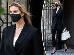 Ivanka Trump heads to work in a starry face mask and a sharp black suit