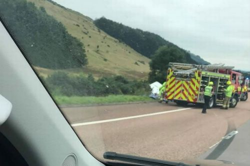 Emergency services race to horror between car and caravan on M90