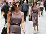 Zoe Hardman flaunts her sizzling physique in a figure-hugging midi dress