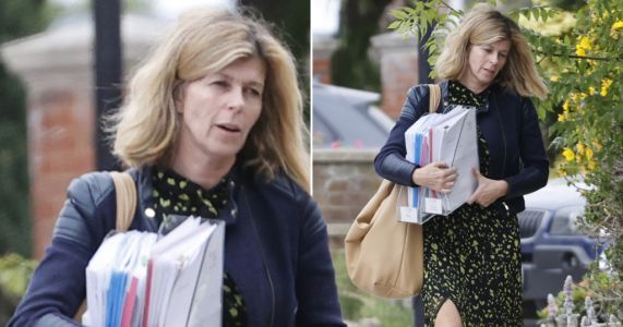 Kate Garraway heads home with armfuls of paperwork after heartbreaking update on Derek