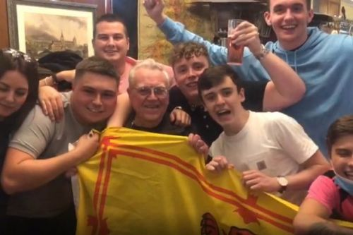 Heartwarming video shows young Tartan Army fans partying with 83-year-old Scot