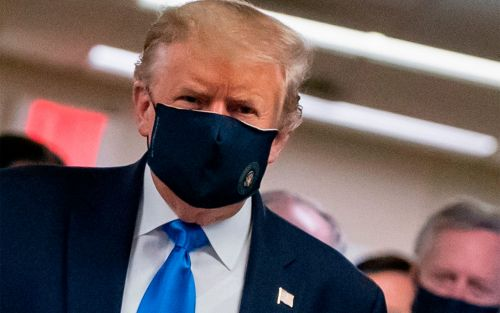 Donald Trump wears a face mask in public for the first time