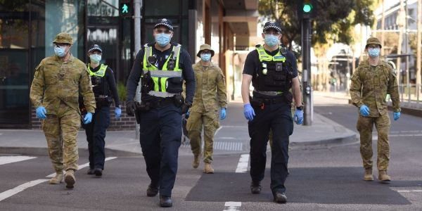 Australia's second-biggest city has implemented a curfew and banned people from going more than 3 miles of their home after a spike in coronavirus infections