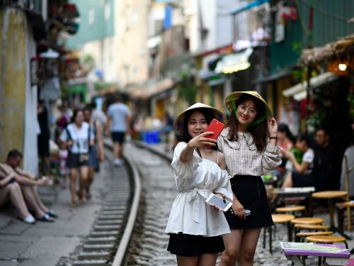Hanoi shut down its Instagram-famous 'train street' cafes because they were overrun with selfie-taking tourists. Here's how it go to this point