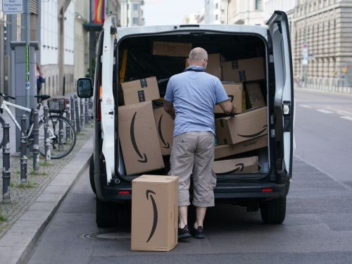 Amazon is encouraging shoppers to pick up their packages in person from stores as the e-commerce industry prepares for a delivery surge