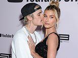 Justin Bieber can't keep his hands and lips off wife Hailey as he attends the premiere of Seasons