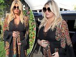 Jessica Simpson debuts her baby bump. just hours after announced she is expecting