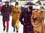 Katie Holmes and her beau Emilio Vitolo Jr make a stylish couple as they stroll through NYC together