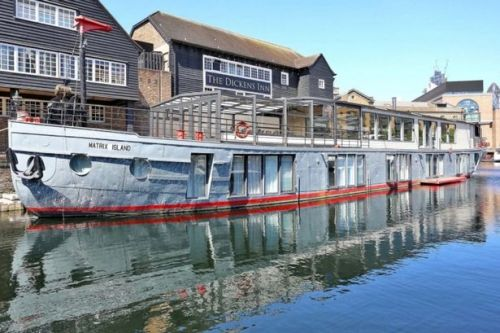 Luxury houseboat with sauna, jet ski dock and floating stove on sale for £3.5m