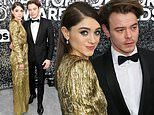 Stranger Things stars Natalia Dyer and Charlie Heaton arm in arm at SAG awards in LA