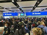 Huge crowds of 'superspreading' travellers wait in line at Heathrow Airport
