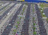 Incredible moment hundreds of Muslims gather in an IKEA car park to pray