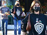 Kaia Gerber wears a Looney Tunes sweatshirt as she is joined by a pal