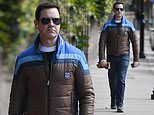 Jimmy Carr walks along the street in jeans after debuting his hair transplant on his latest show