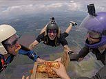 Texas: Skydivers tuck into slices of margherita as they freefall towards the ground from 14,000 feet