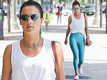 Alessandra Ambrosio puts on a leggy display in blue yoga pants as she steps out for a gym run in LA