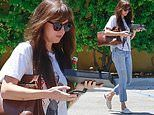 Dakota Johnson pairs denim jeans with a white tee as she goes mask less to run errands