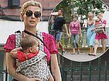 Rachel Riley nails summer chic in a pink mini dress as she cradles 7-month-old daughter Maven
