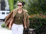 Olivia Wilde packs her bags in LA to reunite with her touring toyboyHarry Styles in Boston