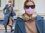 Olivia Palermo makes sartorial statement in camel sweater and culottes with blue overcoat in NYC