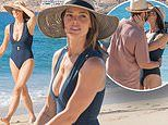 Ashley Greene is stunning in a plunging swimsuit as she kisses husband Paul Khoury