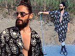 Jared Leto flashes his muscular chest in a half-open shirt as he rocks a head-to-toe Gucci outfit
