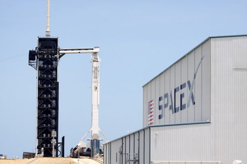 Photos: Falcon 9 and Crew Dragon await next launch attempt
