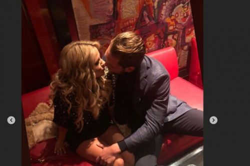 Lewis Burton pines for lost love Caroline Flack as he shares unseen kissing snap