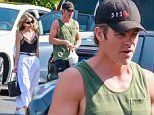 Chris Pine shows off biceps in tank top while grabbing food with Annabelle Wallis in Los Angeles