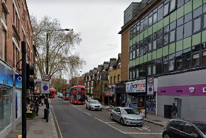 Man stabbed repeatedly outside corner shop in broad daylight attack in north London