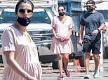 Lea Michele cradles her baby bump during stroll with husband following bad on-set behavior scandal